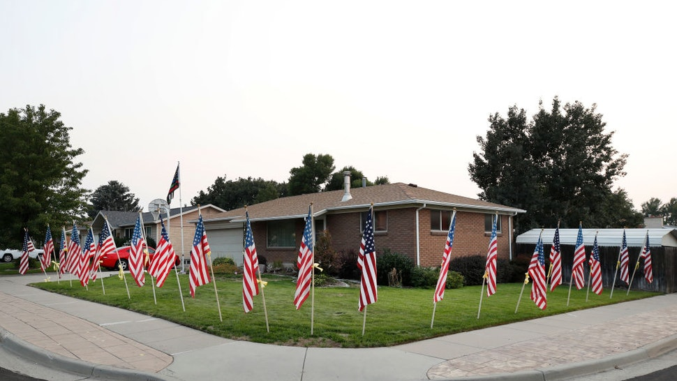 American flags and yellow ribbons line the sidewalk outside the house of Darren Hoover, whose son, Staff Sgt. Taylor Hoover was killed in Afghanistan, on August 27, 2021 in Sandy, Utah.