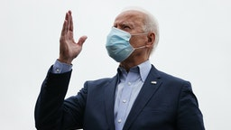 NEW CASTLE, DELAWARE - OCTOBER 12: Wearing a face mask to reduce the risk posed by the coronavirus, Democratic presidential nominee Joe Biden talks to reporters before boarding a flight to Ohio at New Castle County Airport October 12, 2020 in New Castle, Delaware. With 21 days until the election, Biden will campaign in Toledo and Cincinnati. (Photo by Chip Somodevilla/Getty Images)