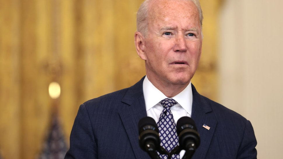 President Biden Delivers Remarks On Status Of Afghanistan Evacuation WASHINGTON, DC - AUGUST 20: U.S. President Joe Biden gestures as delivers remarks on the U.S. military's ongoing evacuation efforts in Afghanistan from the East Room of the White House on August 20, 2021 in Washington, DC. The White House announced earlier that the U.S. has evacuated almost 14,000 people from Afghanistan since the end of July. (Photo by Anna Moneymaker/Getty Images)