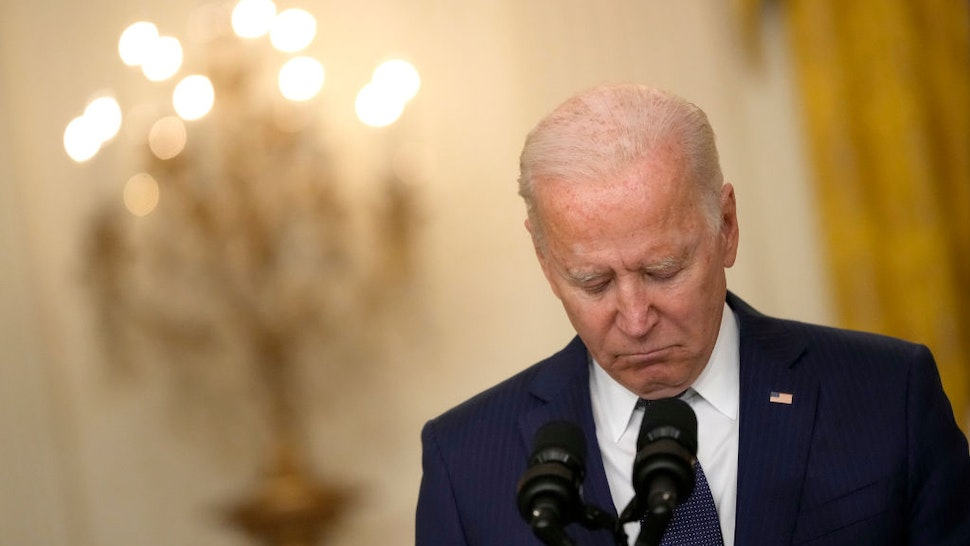 WASHINGTON, DC - AUGUST 26: U.S. President Joe Biden speaks about the situation in Kabul, Afghanistan from the East Room of the White House on August 26, 2021 in Washington, DC. At least 12 American service members were killed on Thursday by suicide bomb attacks near the Hamid Karzai International Airport in Kabul, Afghanistan. (Photo by Drew Angerer/Getty Images)