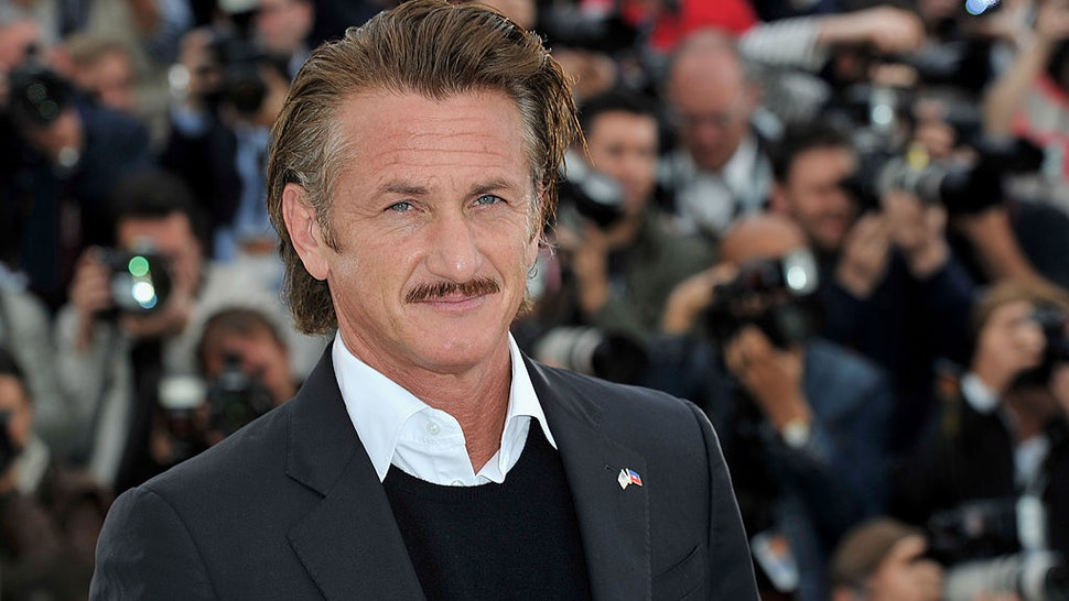 """CANNES, FRANCE - MAY 18: Actor Sean Penn poses at the """"Haiti Carnaval In Cannes"""" photocall during the 65th Annual Cannes Film Festival on May 18, 2012 in Cannes, France. (Photo by Gareth Cattermole/Getty Images)"""