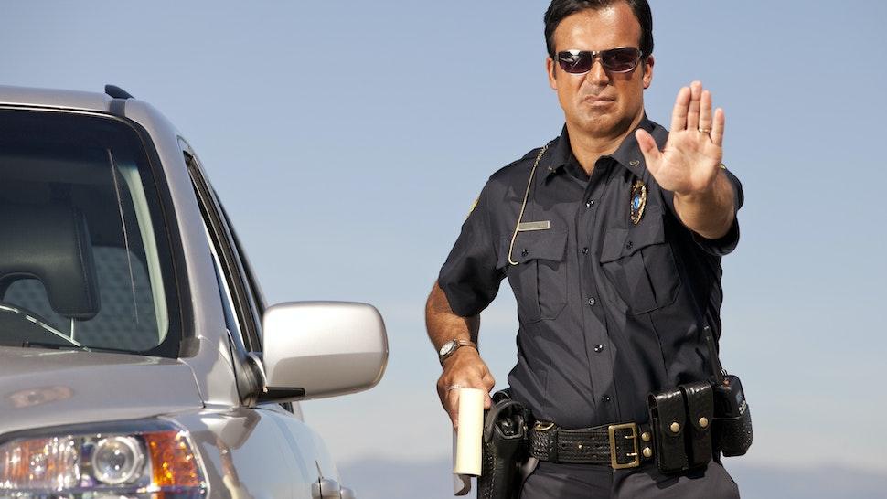 Police Officer gesturing Halt - stock photo