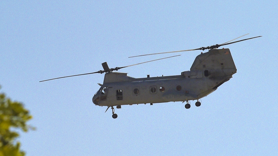 A US military helicopter is pictured flying near the US embassy in Kabul on August 15, 2021.