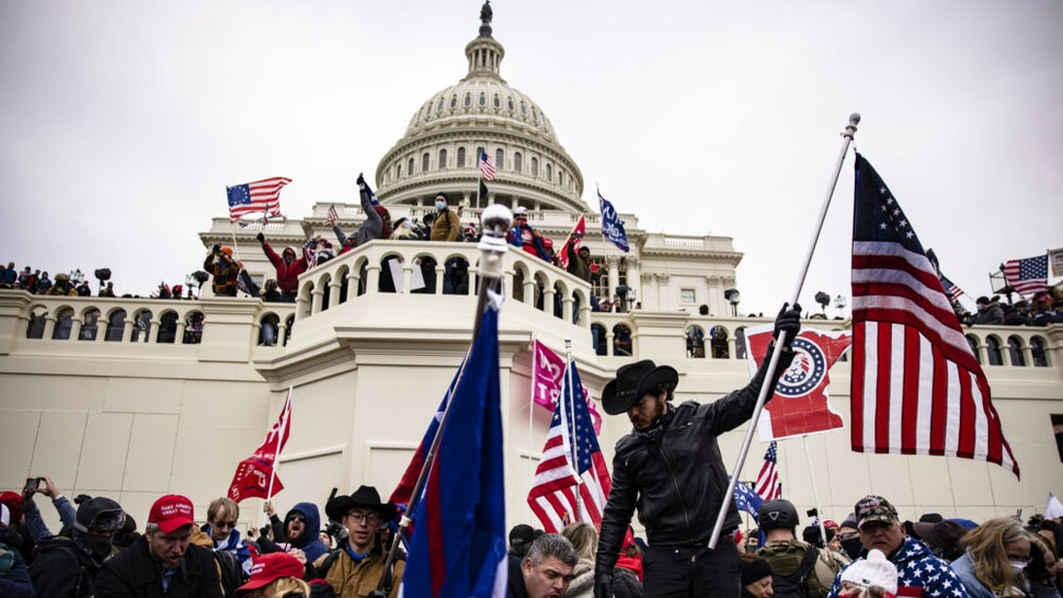 WASHINGTON, DC - JANUARY 06: Pro-Trump supporters storm the U.S. Capitol following a rally with President Donald Trump on January 6, 2021 in Washington, DC. Trump supporters gathered in the nation's capital today to protest the ratification of President-elect Joe Biden's Electoral College victory over President Trump in the 2020 election.