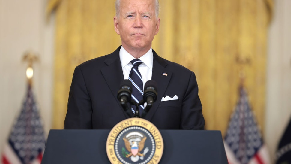 WASHINGTON, DC - AUGUST 18: U.S. President Joe Biden pauses as he delivers remarks on the COVID-19 response and the vaccination program in the East Room of the White House on August 18, 2021 in Washington, DC. During his remarks, President Biden announced that he is ordering the United States Department of Health and Human Services to require nursing homes to have vaccinated staff in order for them to receive Medicare and Medicaid funding. The President also announced that Americans would be able to receive a third booster shot against Covid-19.