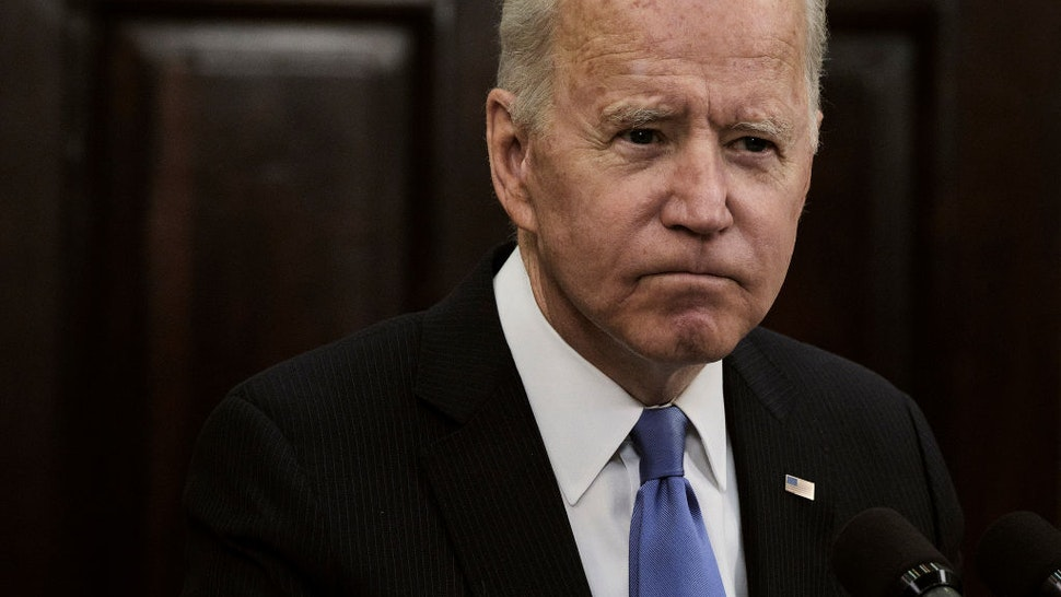 WASHINGTON, DC - MAY 13, 2021: President Joe Biden speaks about the Colonial Pipeline hacking incident, in the Roosevelt Room at the White House in Washington, D.C., on May 13, 2021. The company announced that the pipeline was restarting, but supply to gas stations may take several days to return to normal.