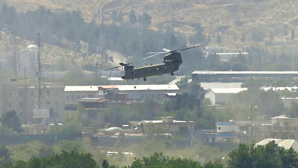 A US military helicopter is pictured flying above the US embassy in Kabul on August 15, 2021.