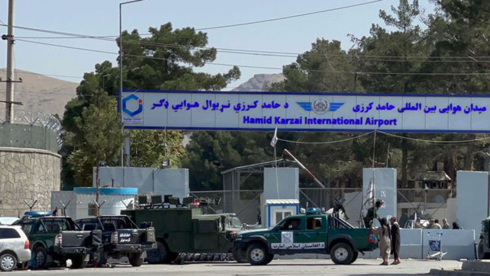 KABUL, AFGHANISTAN - AUGUST 27: Taliban members stand guard at a checkpoint near Hamid Karzai International Airport, the center of evacuation efforts from Afghanistan since the Taliban took over, after yesterday's two explosion in Kabul, Afghanistan on August 27, 2021.