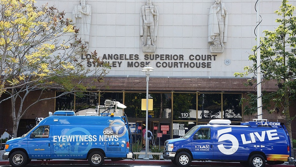 Television news broadcasting vans are parked outside of Los Angeles Superior Court where media are reporting from on the first day of trial of Katherine Jackson and Michael's children against concert promoter AEG Live at Los Angeles Superior Court on April 02, 2013 in Los Angeles, California.