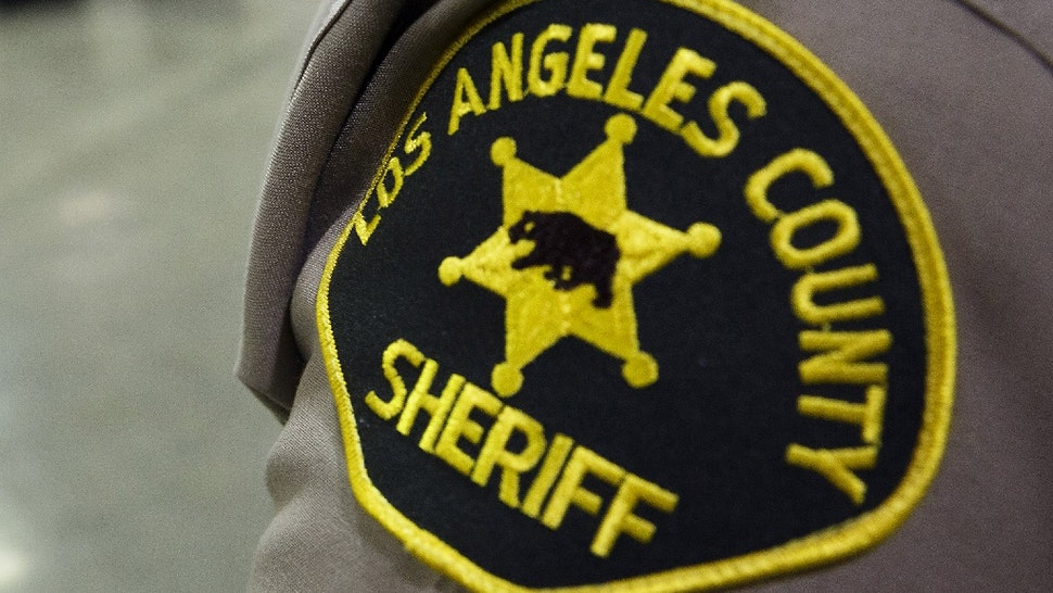 A Los Angeles County Sheriffs Department patch is seen on the shoulder of a deputy at the Los Angeles County Sheriffs Department Twin Towers Correctional Facility in Los Angeles, California, U.S., on Tuesday, Sept. 23, 2014.
