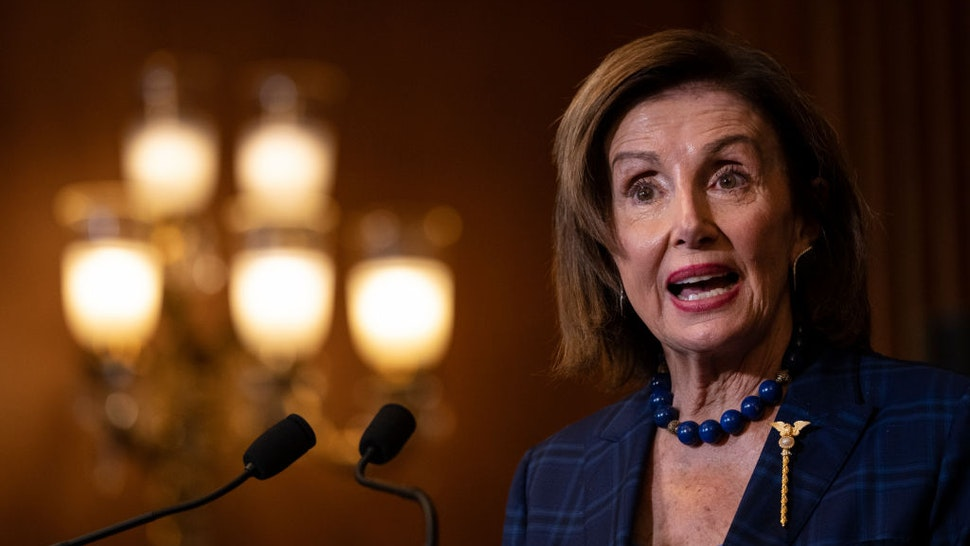 WASHINGTON, DC - JULY 30: Speaker of the House Nancy Pelosi (D-CA) speaks during a bill enrollment ceremony for the Emergency Security Supplemental Appropriations Act at the U.S. Capitol on July 30, 2021 in Washington, DC. The bill provides $1.9 billion in FY2021 for emergency supplemental appropriations for the legislative branch and federal agencies to respond to the attack on the U.S. Capitol Complex that occurred on January 6, 2021. (Photo by Drew Angerer/Getty Images)