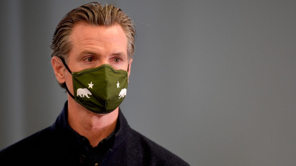 SANTA ANA, CA - MARCH 25: California Governor Gavin Newsom announces new eligibility during a press conference at a COVID-19 vaccination site at AltaMed in Santa Ana, CA, on Thursday, March 25, 2020.