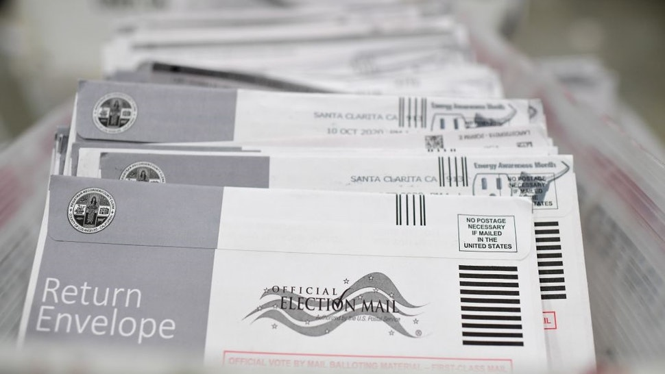 Mail-in ballots in their envelopes await processing at the Los Angeles County Registrar Recorders' mail-in ballot processing center at the Pomona Fairplex in Pomona, California, October 28, 2020.