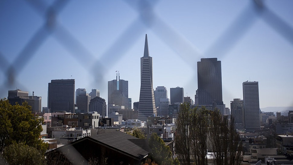 SAN FRANCISCO, CA - OCTOBER 11: The skyline of San Francisco is seen behind a fence on October 11, 2013 in San Francisco, United States.