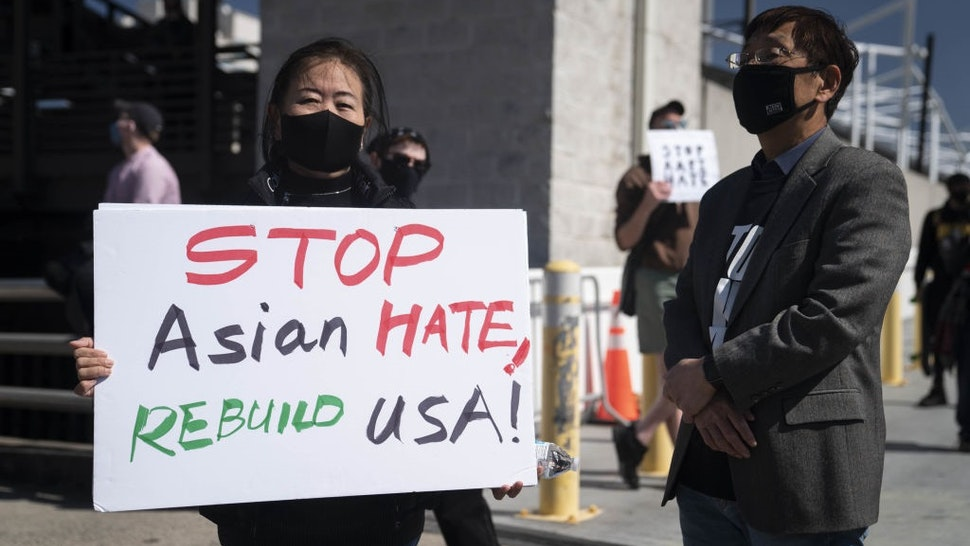 Demonstrators march to CNN Center following a Stop AAPI Hate Rally in Atlanta, Georgia, U.S., on Saturday, March 20, 2021.