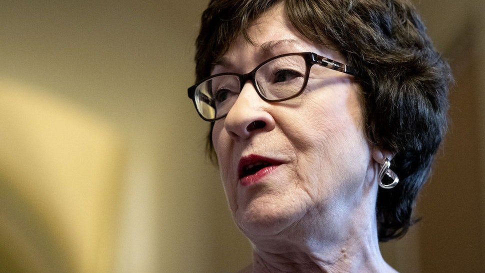 Senator Susan Collins, a Republican from Maine, speaks to members of the media following a meeting in the office of Senate Minority Leader Mitch McConnell, a Republican from Kentucky, not pictured, at the U.S. Capitol in Washington, D.C., U.S., on Wednesday, July 28, 2021. Senators negotiating the terms of a $579 billion infrastructure plan chipped away at some of the issues that had been holding up an agreement but have yet to find a breakthrough on other differences that would seal an agreement and lead to a vote on legislation. Photographer: Stefani Reynolds/Bloomberg