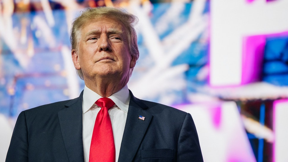 PHOENIX, ARIZONA - JULY 24: Former U.S. President Donald Trump makes an entrance at the Rally To Protect Our Elections conference on July 24, 2021 in Phoenix, Arizona. The Phoenix-based political organization Turning Point Action hosted former President Donald Trump alongside GOP Arizona candidates who have begun candidacy for government elected roles.