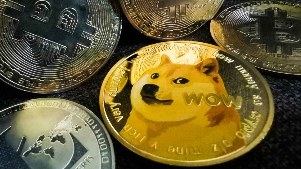 Representation of Bitcoin and Dogecoin cryptocurrencies are seen in this illustration photo taken in Sulkowice, Poland on August 10, 2021. (Photo Illustration by