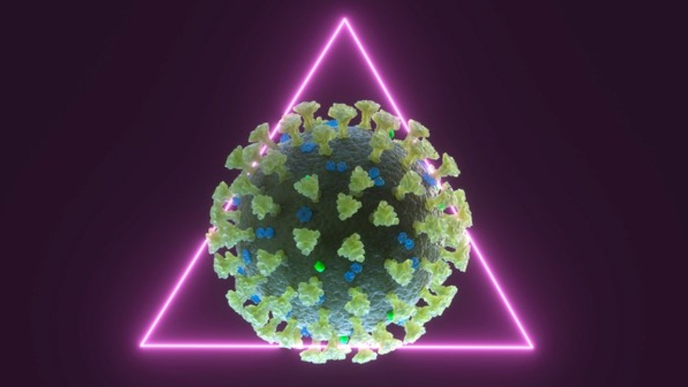 Digital generated image of COVID-19 cell inside triangular pink neon shape on purple background.