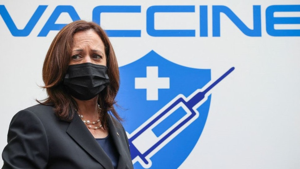 US Vice President Kamala Harris visits the National Institute of Hygiene and Epidemiology (NIHE) where 270,000 doses of Pfizer vaccine arrived earlier in the morning, in Hanoi, Vietnam, August 26, 2021. (Photo by EVELYN HOCKSTEIN / POOL / AFP) (Photo by E