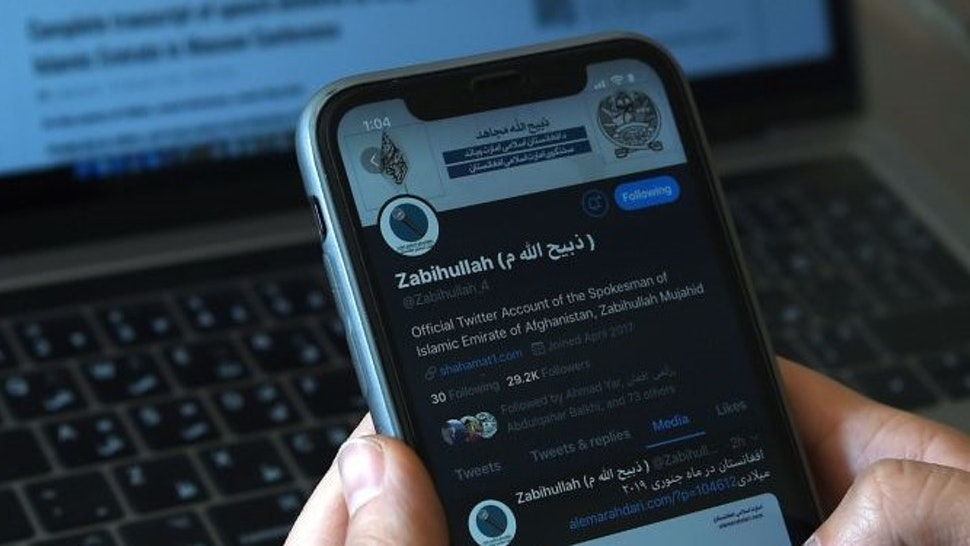In this photo taken on February 6, 2019, an Afghan reporter browses the Twitter page of Taliban spokesman Zabihullah Mujahid in the newsroom at Maiwand TV station in Kabul. - Fighting fake news, publishing across myriad social media accounts and relying on an army of interns -- this is the Talibans sprawling propaganda machine that has embraced modernity even as the group vows to enforce Islamist controls on journalists if it returns to power. (Photo by WAKIL KOHSAR / AFP) / TO GO WITH: Afghanistan-Taliban-media, FOCUS by David STOUT and Sajjad TARAKZAI (Photo by