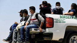 US-Mexico border SAN LUIS, AZ - MAY 21: Migrants attempting to cross in to the U.S. from Mexico are detained by U.S. Customs and Border Protection at the border May 21, 2021 in San Luis, Arizona. (Photo by Nick Ut/Getty Images) Nick Ut / Contributor via Getty Images