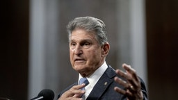 U.S. Lawmakers Narrow Infrastructure Gaps Without Reaching Deal Senator Joe Manchin, a Democrat from West Virginia, speaks during a news conference in the Dirksen Senate Office Building in Washington, D.C., U.S., on Wednesday, July 28, 2021. A bipartisan group of senators and the White House reached a tentative agreement on a $550 billion infrastructure package, a significant breakthrough in the drive to muscle through Congress a massive infusion of spending for roads, bridges and other critical projects. Photographer: Stefani Reynolds/Bloomberg via Getty Images Bloomberg / Contributor via Getty Images