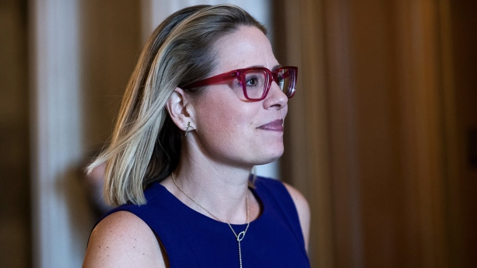 Senate Votes UNITED STATES - JUNE 10: Sen. Kyrsten Sinema, D-Ariz., is seen during a vote in the Capitol on Thursday, June 10, 2021. (Photo By Tom Williams/CQ-Roll Call, Inc via Getty Images) Tom Williams / Contributor
