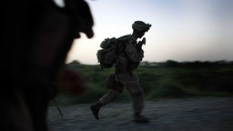 U.S. Marines Continue Suppression Of Insurgents MIAN POSHTEH, AFGHANISTAN - JULY 14: U.S. Marines with the 2nd Marine Expeditionary Brigade, RCT 2nd Battalion 8th Marines Echo Co. rush down a road after seeing suspicious activity near their base on July 14, 2009 in Mian Poshteh, Afghanistan . The Marines are part of Operation Khanjari which was launched to take areas in the Southern Helmand Province that Taliban fighters are using as a resupply route and to help the local Afghan population prepare for the upcoming presidential elections. (Photo by Joe Raedle/Getty Images) Joe Raedle / Staff