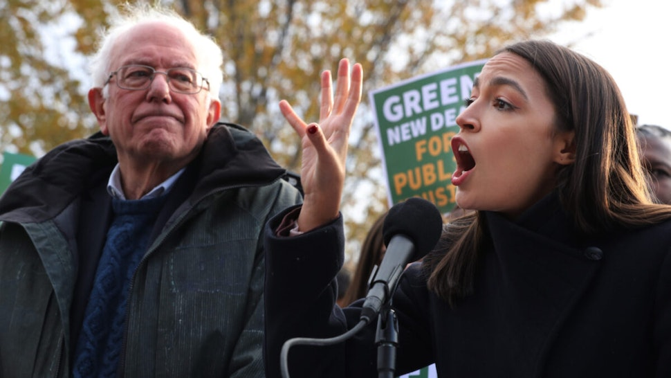 Democratic presidential candidate Sen. Bernie Sanders (I-VT) (L) and Rep. Alexandria Ocasio-Cortez (D-NY) hold a news conference to introduce legislation to transform public housing as part of their Green New Deal proposal outside the U.S. Capitol November 14, 2019 in Washington, DC.