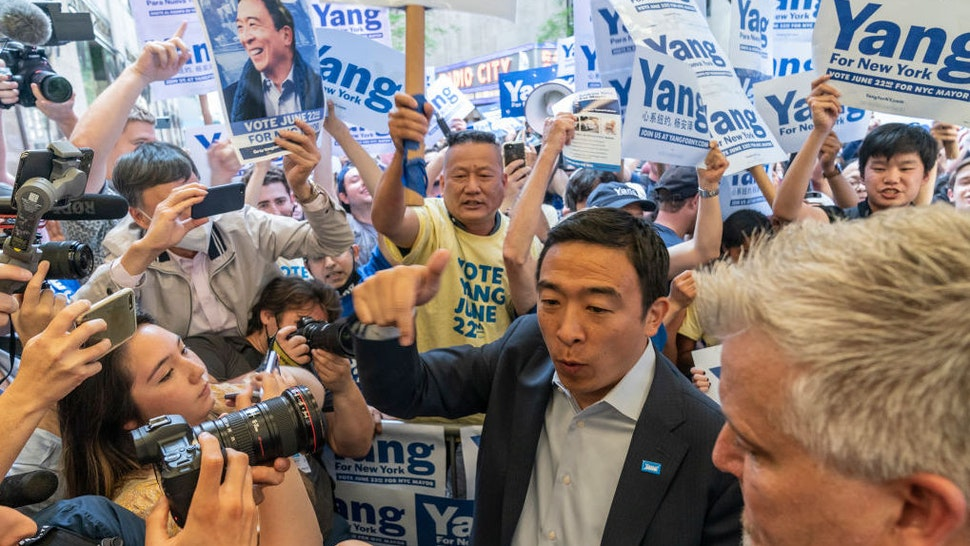 NEW YORK, UNITED STATES - 2021/06/16: Mayoral candidate Andrew Yang arrives for debate at NBC Studios at Rockefeller Center. He greets supporters gathering outside to appreciate their support. Eight candidates according to the city electoral commission qualified for debates: Eric Adams, Kathryn Garcia, Maya Wiley, Andrew Yang, Scott Stringer, Ray McGuire, Shaun Donovan and Dianne Morales. Supporters for each candidate staged a rally outside NBC center.
