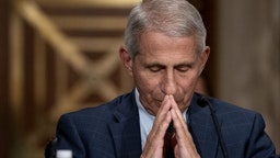 Anthony Fauci, director of the National Institute of Allergy and Infectious Diseases, listens during a Senate Health, Education, Labor, and Pensions Committee confirmation hearing in Washington, D.C., U.S., on Tuesday, July 20, 2021.