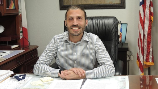 "12 May 2021, US, Del Rio: Bruno Lozano, Democratic mayor of the U.S. border city of Del Rio, sits at his desk in City Hall. (to dpa: ""Biden's problem zone"") Photo: Lena Klimkeit/dpa"