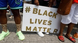 COLUMBUS, OHIO, UNITED STATES - 2021/07/31: Supporters of Casey Goodson Jr. hold a # Black Lives Matter placard detailed in sparkling gold letters, during the march and rally. Friends and family of Casey Goodson Jr. were joined by Black Lives Matter activists outside of the Franklin County Common Pleas Courthouse for a march and rally to indict former Sheriff Deputy Jason Meade, who shot and killed Casey Goodson Jr. in December of 2020. This rally fell on the birthday of Tamala Payne, the mother of Casey Goodson Jr., and featured prayers from local pastors, a word from family attorney Sean Walton, words from Payne and a brief reflection on Goodson Jr.s character from his younger brother Bredlen Harper Jr. before marching through downtown.