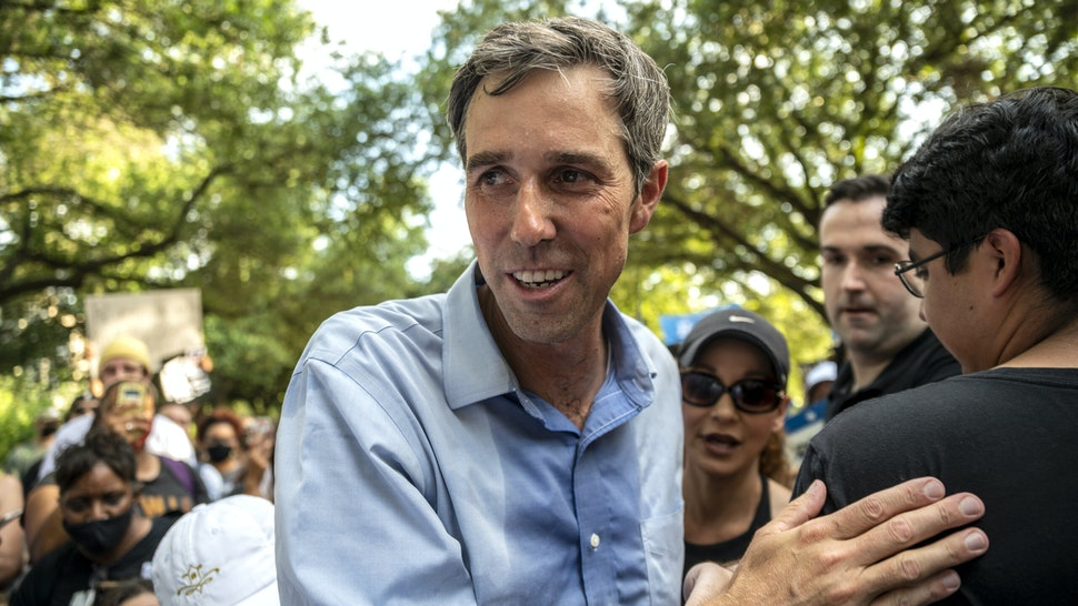 AUSTIN, TX - JUNE 20: Former U.S. Rep. Beto O'Rourke (D-TX) walks through a crowd at the state Capitol on June 20, 2021 in Austin, Texas. The rally is one of many O'Rourke is holding across Texas to fight SB7, a controversial voting bill that was derailed after house Democrats walked out of the session. The bill set limits on early voting hours, banned drive-through voting, made it a felony for officials to send unsolicited absentee ballot requests and lowered the standard for overturning an election based on fraud. Gov. Greg Abbott has vowed to call a special session on the measure.