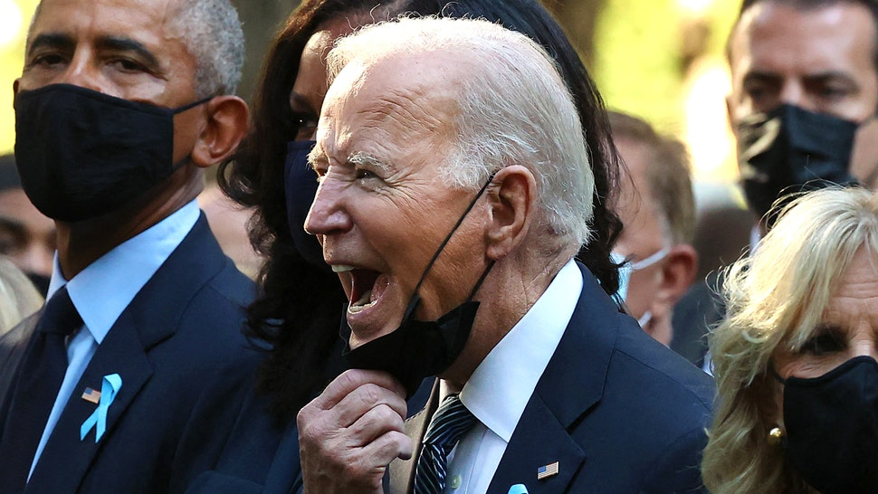 President Joe Biden (C) calls out as he is joined by (L-R) former President Bill Clinton, former First Lady Hillary Clinton, former President Barack Obama, former First Lady Michelle Obama, First Lady Jill Biden and former New York City Mayor Michael Bloomberg, during the annual 9/11 Commemoration Ceremony at the National 9/11 Memorial and Museum on September 11, 2021 in New York.