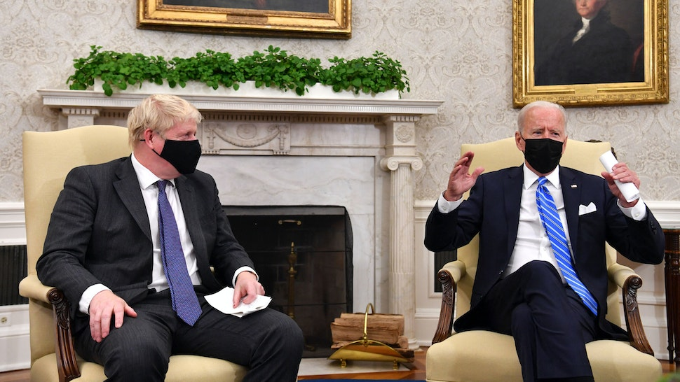 US President Joe Biden (R) holds a bilateral meeting with Britain's Prime Minister Boris Johnson at the Oval Office of the White House in Washington, DC on September 21, 2021.