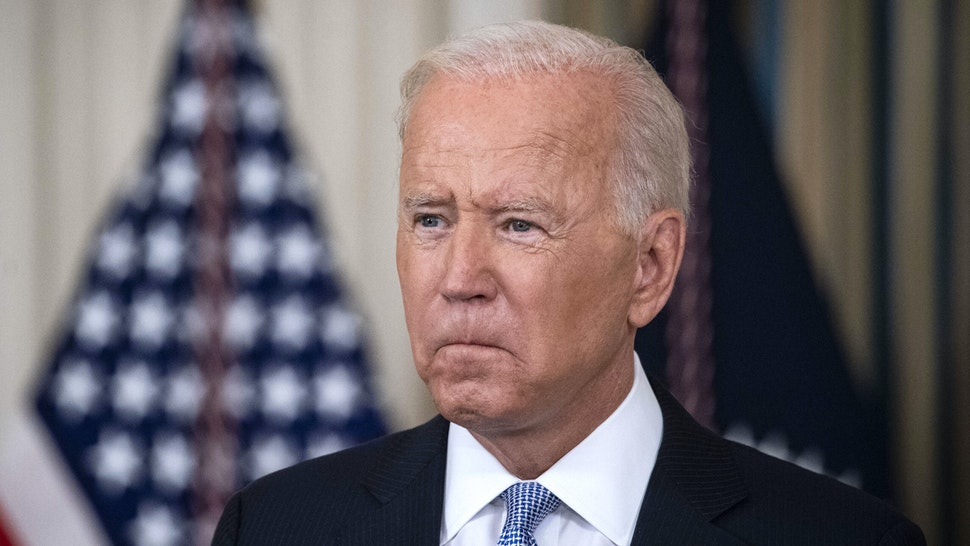 U.S. President Joe Biden pauses while speaking in the State Dining Room of the White House in Washington, D.C., U.S., on Friday, Sept. 24, 2021. The U.S. will begin giving Covid-19 booster shots to millions of Americans today, a watershed moment in the nation's battle against the pandemic that officials hope will beat back another brutal winter wave of infections.
