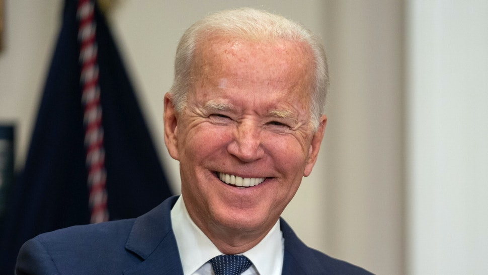 U.S. President Joe Biden smiles while speaking in the Roosevelt Room of the White House in Washington, D.C., U.S., on Sunday, Aug. 22, 2021. Biden said the U.S. has expanded its evacuation efforts beyond the perimeter of the Kabul airport, warned of possible terror attacks and acknowledged that he may be forced to push back his deadline for leaving Afghanistan.