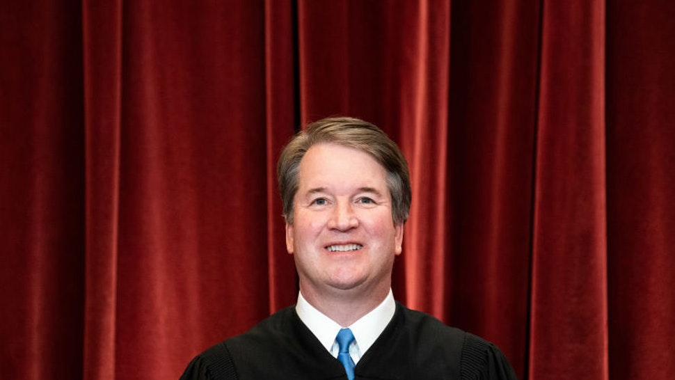 WASHINGTON, DC - APRIL 23: Associate Justice Brett Kavanaugh stands during a group photo of the Justices at the Supreme Court in Washington, DC on April 23, 2021.