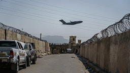 A C-17 Globemaster takes off as Taliban fighters secure the outer perimeter, alongside the American controlled side of of the Hamid Karzai International Airport in Kabul, Afghanistan, Sunday, Aug. 29, 2021.