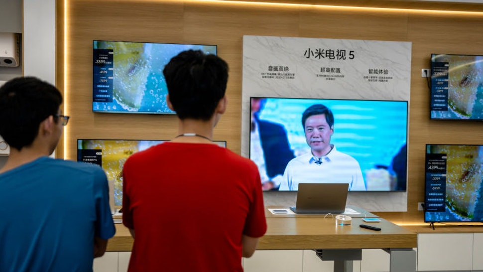 SHAOXING, CHINA - AUGUST 10: A TV inside a Xiaomi store broadcasts live Xiaomi's online product launch event on August 10, 2021 in Shaoxing, Zhejiang Province of China. Xiaomi founder and CEO Lei Jun launched Mi MIX 4 smartphones on Tuesday.