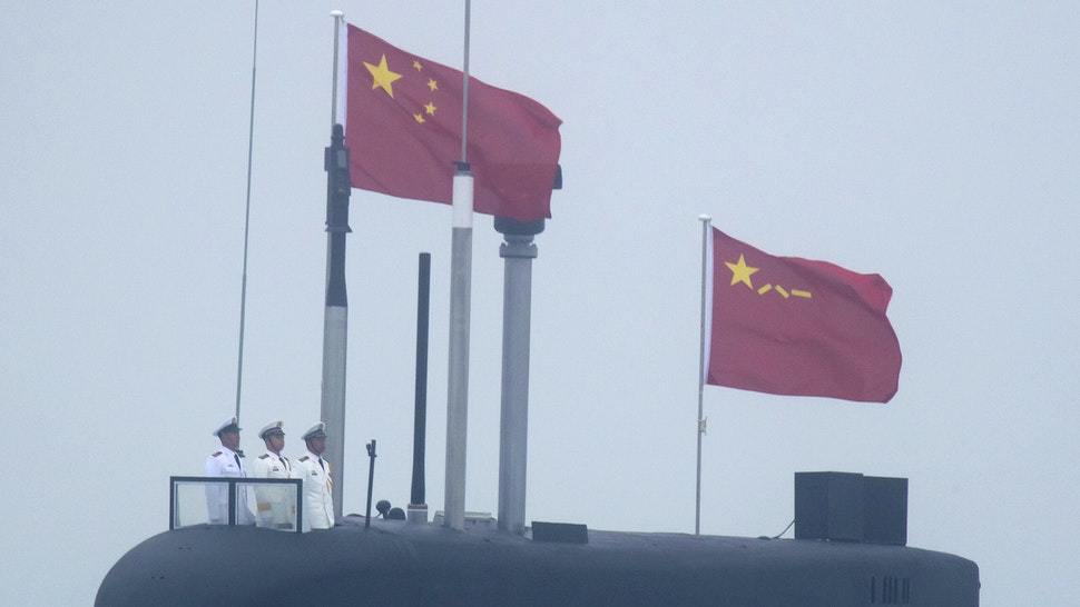 A new type 094A Jin-class nuclear submarine Long March 10 of the Chinese People's Liberation Army (PLA) Navy participates in a naval parade to commemorate the 70th anniversary of the founding of China's PLA Navy in the sea near Qingdao, in eastern China's Shandong province on April 23, 2019. - China celebrated the 70th anniversary of its navy by showing off its growing fleet in a sea parade featuring a brand new guided-missile destroyer.