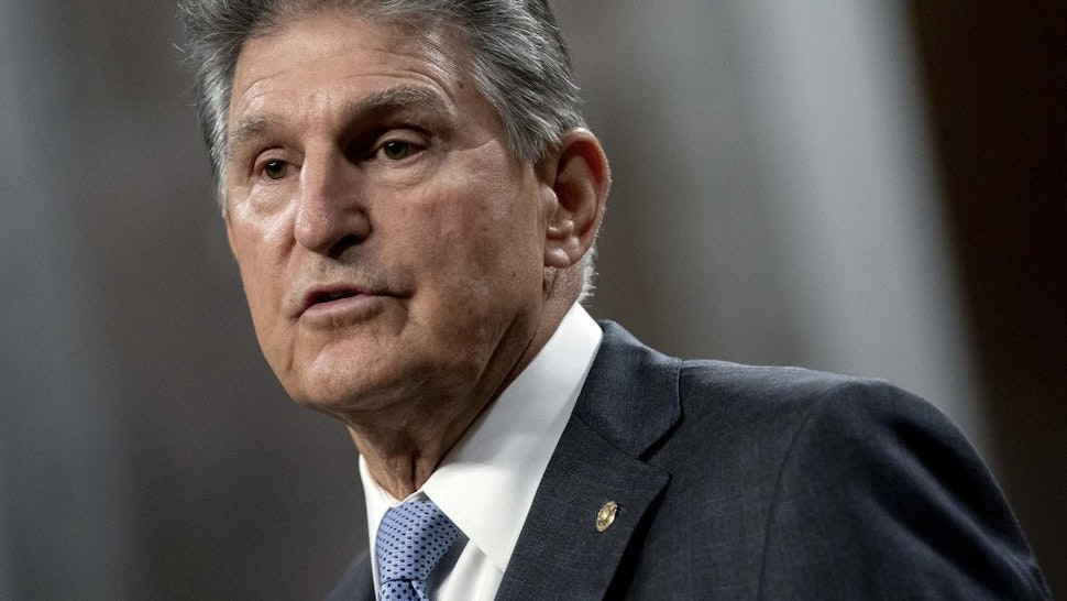U.S. Lawmakers Narrow Infrastructure Gaps Without Reaching Deal Senator Joe Manchin, a Democrat from West Virginia, speaks during a news conference in the Dirksen Senate Office Building in Washington, D.C., U.S., on Wednesday, July 28, 2021. A bipartisan group of senators and the White House reached a tentative agreement on a $550 billion infrastructure package, a significant breakthrough in the drive to muscle through Congress a massive infusion of spending for roads, bridges and other critical projects. Photographer: Stefani Reynolds/Bloomberg via Getty Images Bloomberg / Contributor