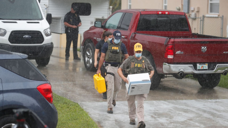 NORTH PORT, FL - SEPTEMBER 20: FBI agents begin to take away evidence from the family home of Brian Laundrie, who is a person of interest after his fiancé Gabby Petito went missing on September 20, 2021 in North Port, Florida. A body has been found by authorities in Wyoming that fits the description of Petito, who went missing while on a cross country trip with Laundrie. (Photo by Octavio Jones/Getty Images)