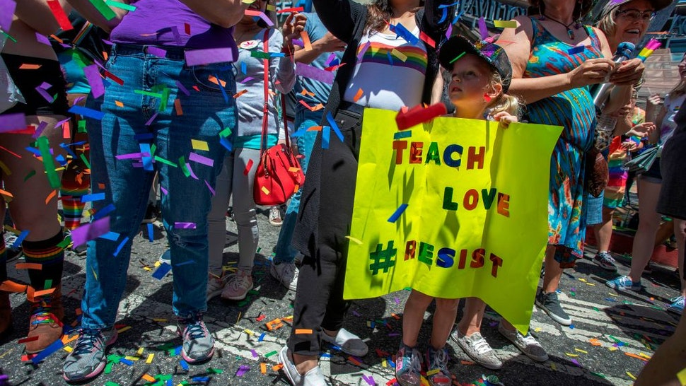 TOPSHOT - A young girl holds a sign during the annual LA Pride Parade in West Hollywood, California, on June 9, 2019. - LA Pride began on June 28, 1970, exactly one year after the historic Stonewall Rebellion in New York City, 50 years ago. (Photo by DAVID MCNEW / AFP) (Photo credit should read DAVID MCNEW/AFP via Getty Images)