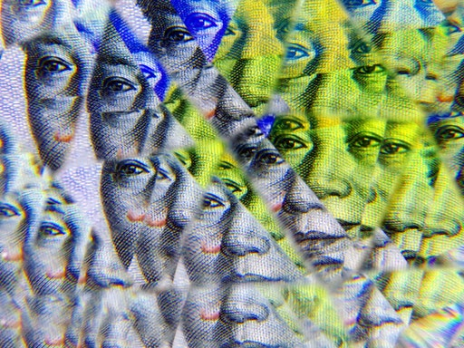 Chinese yuan banknote kaleidoscope pattern; close-up on face of Mao