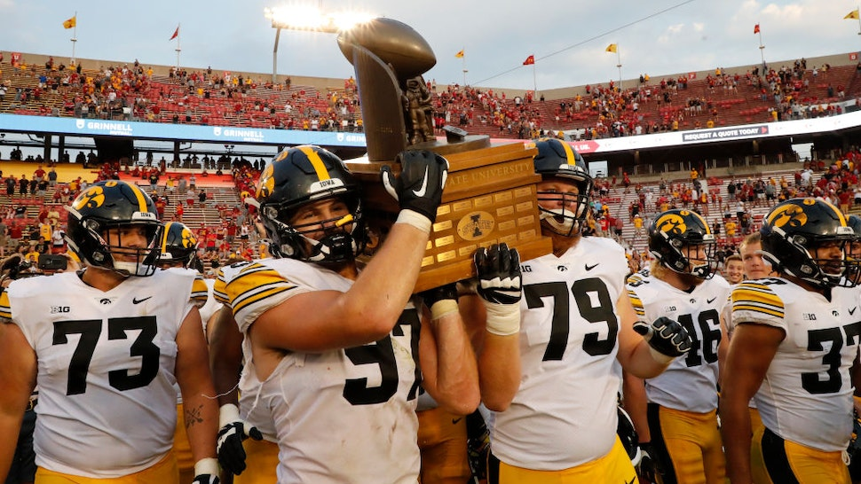 AMES, IA - SEPTEMBER 11: Defensive lineman Zach VanValkenburg #97 of the Iowa Hawkeyes and offensive lineman Jack Plumb #79 of the Iowa Hawkeyes carry the Cy-Hawk Trophy off the field after defeating the Iowa State Cyclones 27-17 at Jack Trice Stadium on September 11, 2021 in Ames, Iowa. The Iowa Hawkeyes won 27-17 over the Iowa State Cyclones. (Photo by David Purdy/Getty Images)