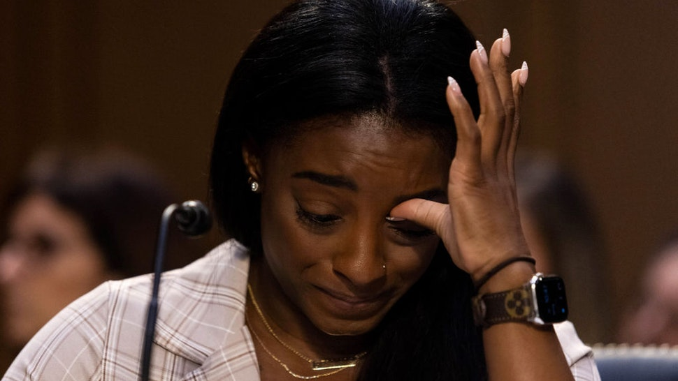 U.S. Olympic gymnast Simone Biles testifies during a Senate Judiciary hearing about the Inspector General's report on the FBI's handling of the Larry Nassar investigation on Capitol Hill, on September 15, 2021 in Washington, DC. Nassar was charged in 2016 with federal child pornography offenses and sexual abuse charges in Michigan. He is now serving decades in prison after hundreds of girls and women said he sexually abused them under the guise of medical treatment when he worked for Michigan State and Indiana-based USA Gymnastics, which trains Olympians. (Photo by Graeme Jennings-Pool/Getty Images)