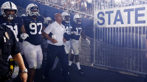 UNIVERSITY PARK, PA - SEPTEMBER 18: Penn State Nittany Lions head coach James Franklin leads his team to the field for a college football game against the Auburn Tigers on Sept. 18, 2021 at Beaver Stadium in University Park, Pennsylvania. (Photo by Joe Robbins/Icon Sportswire via Getty Images)